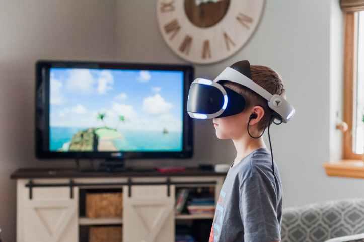 boy using virtual reality goggles